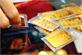 Vàng tăng giá nhẹ, USD đứng trên mức 21.400 VND