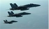 Tổng thống Obama ký dự luật chi gần 600 tỷ USD cho quốc phòng