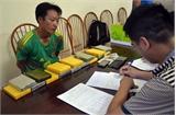 Bắt đối tượng vận chuyển 16 bánh heroin ở Điện Biên