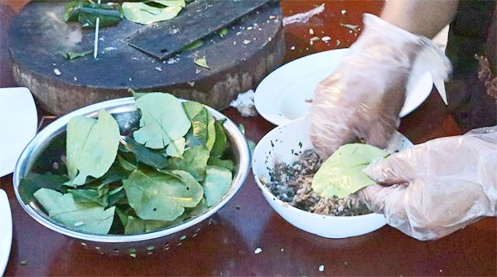 Pork in grapefruit leaves, Muong delicacy, food connoisseurs, Muong ethnic group, Hoa Binh Province,  cha cuon la buoi, daily family staple, banh oc nhon, cone-shaped cake