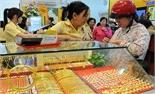 Giá USD tăng, vàng miếng SJC giảm nhẹ