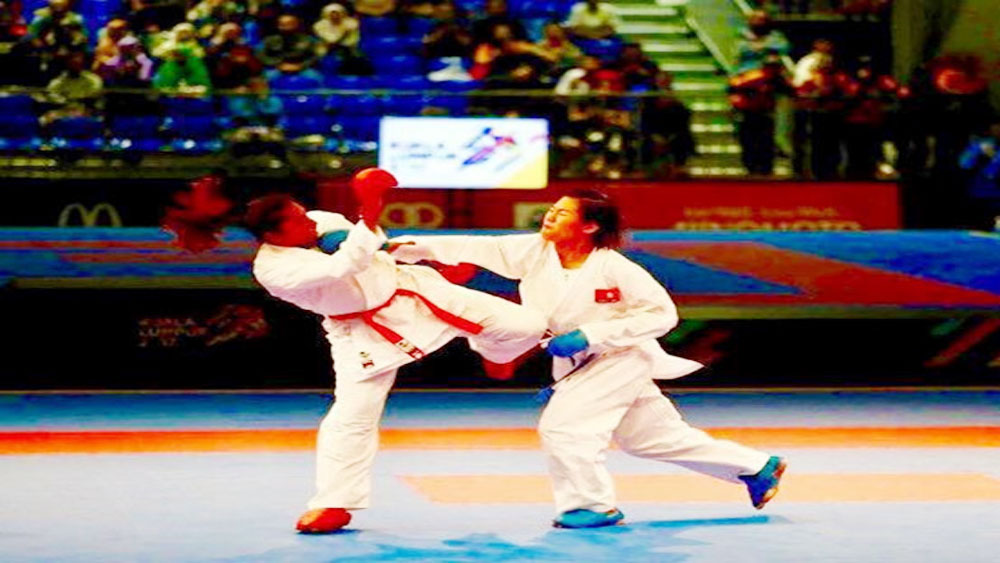 Vietnamese girl fights her way to historic gold at international karate tournament