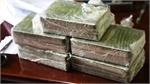 Hai đối tượng vận chuyển 20 bánh heroin sa lưới