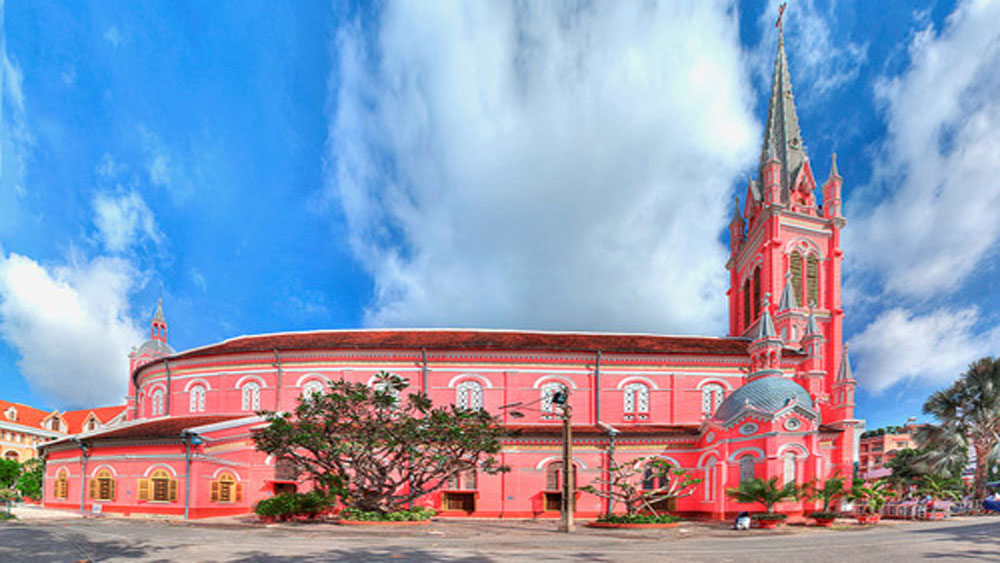 The pink church with the snap-happy worshippers in Saigon