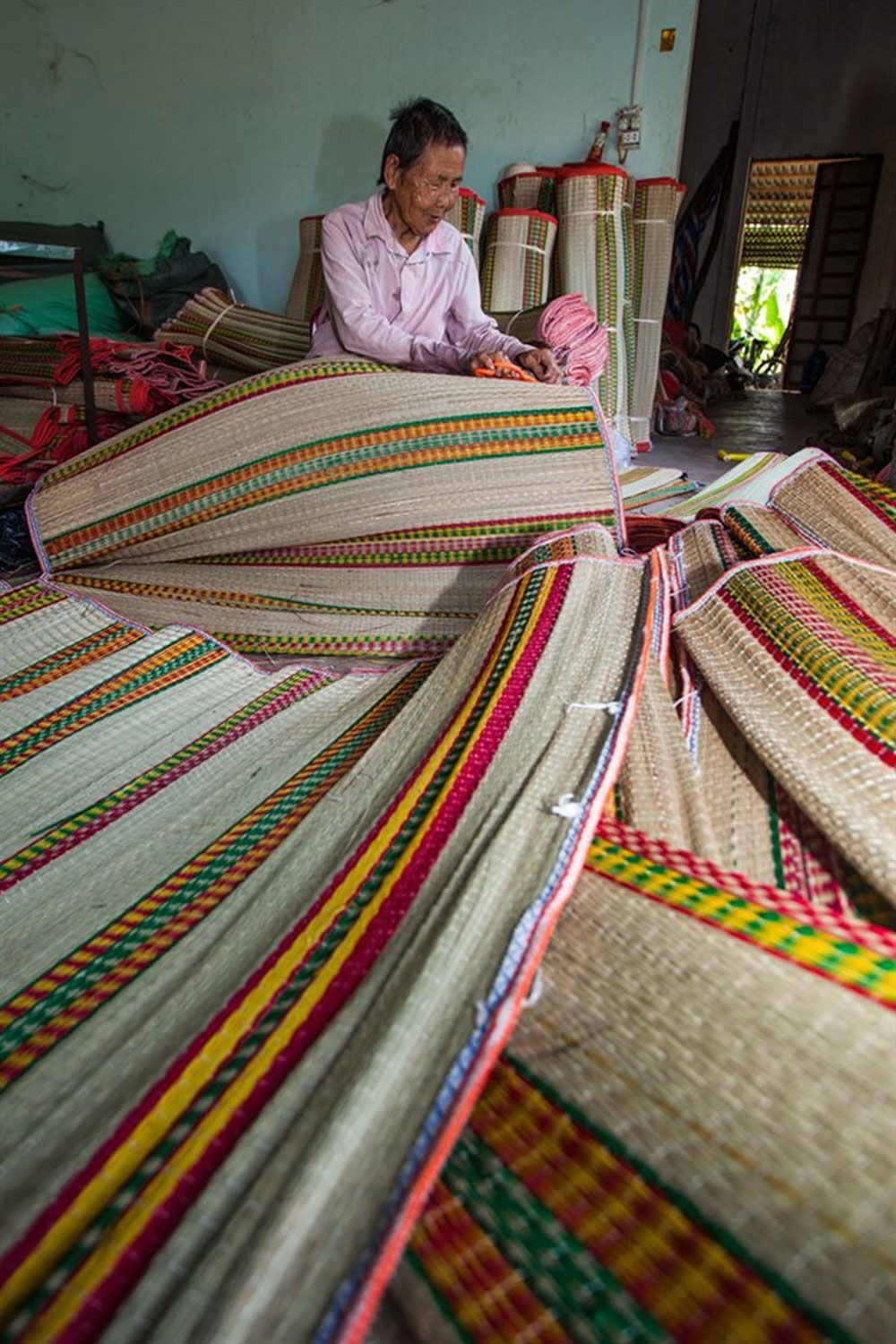 New machines, mat weaving village, labor intensive,  traditional craft, old production method,  initial investment