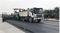 Rải thảm mặt đường đoạn đầu tiên trên cao tốc Bắc Giang - Lạng Sơn