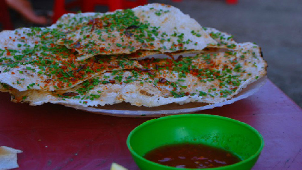 Get your lips around this crispy rice paper wonder in central Vietnam
