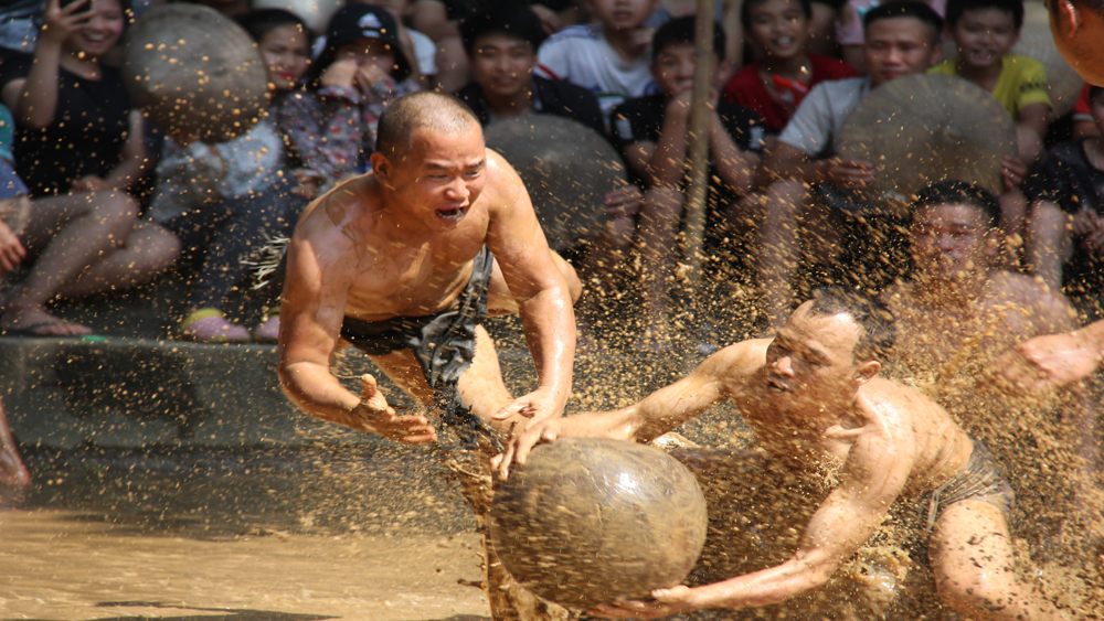 Bac Giang province, Van village, mud ball, wrestling festival, wet rice culture, bumper harvests, good weather,  unique festival,  muddy surface