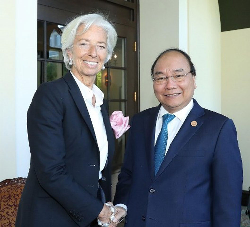 Prime Minister, World Bank, IMF, Vietnam's development, Vietnamese Government, International Monetary Fund, macroeconomic policy, low inflation rate, infrastructure development, climate change response, poverty reduction