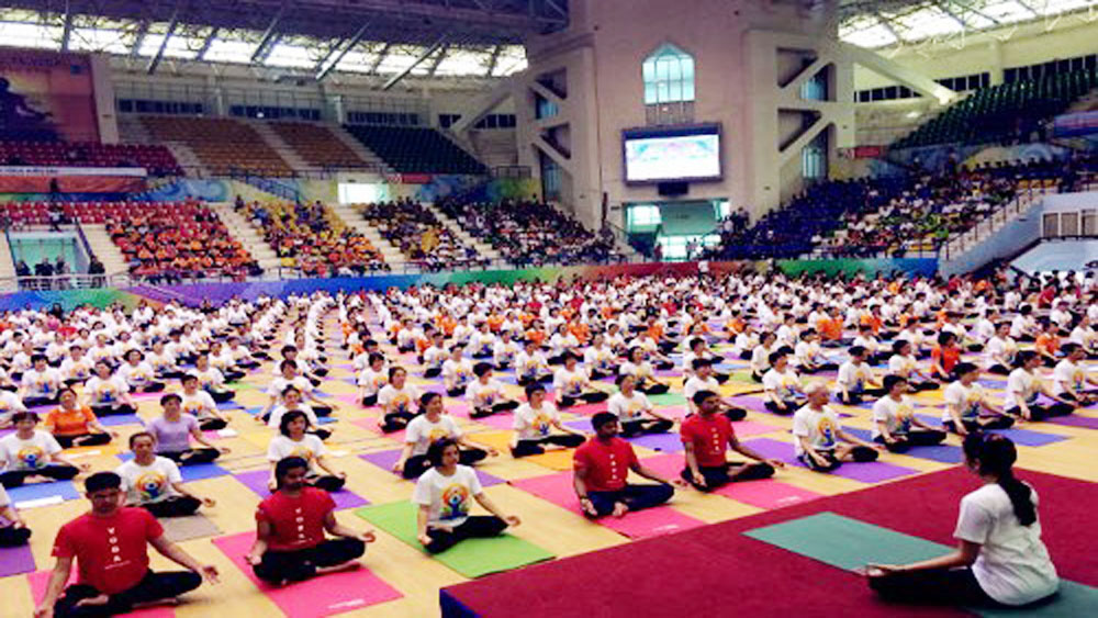 Hanoi, yoga performance, yoga protocol performance, Indoor Athletics Palace, International Day of Yoga, health and life quality, Vietnamese people, Indian musical concert