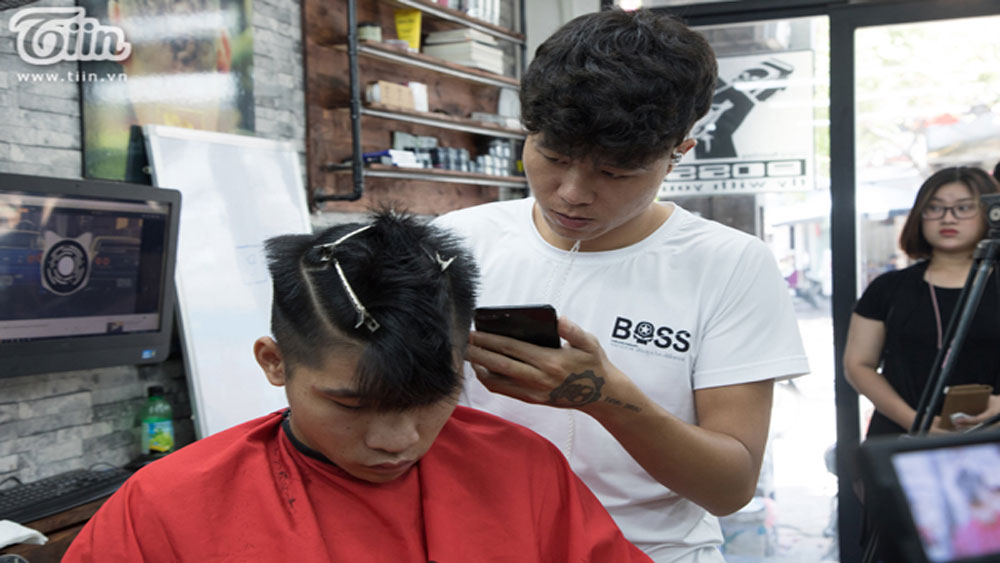 Vietnamese fans let their hair down in World Cup craze