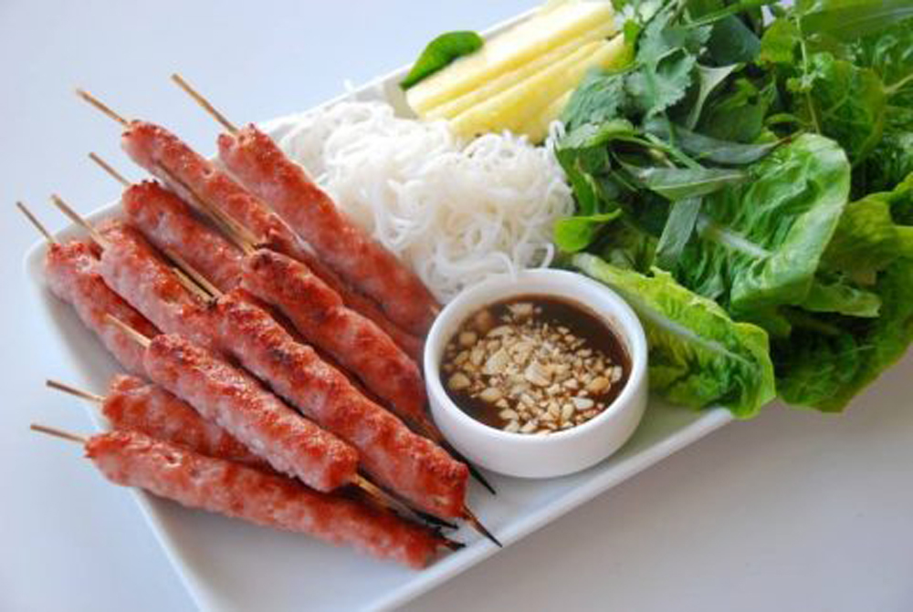 Vietnamese dish, fermented pork roll, Nem chua, Old Quarter, sweet taste,  rustic ingredients, sweet and spicy