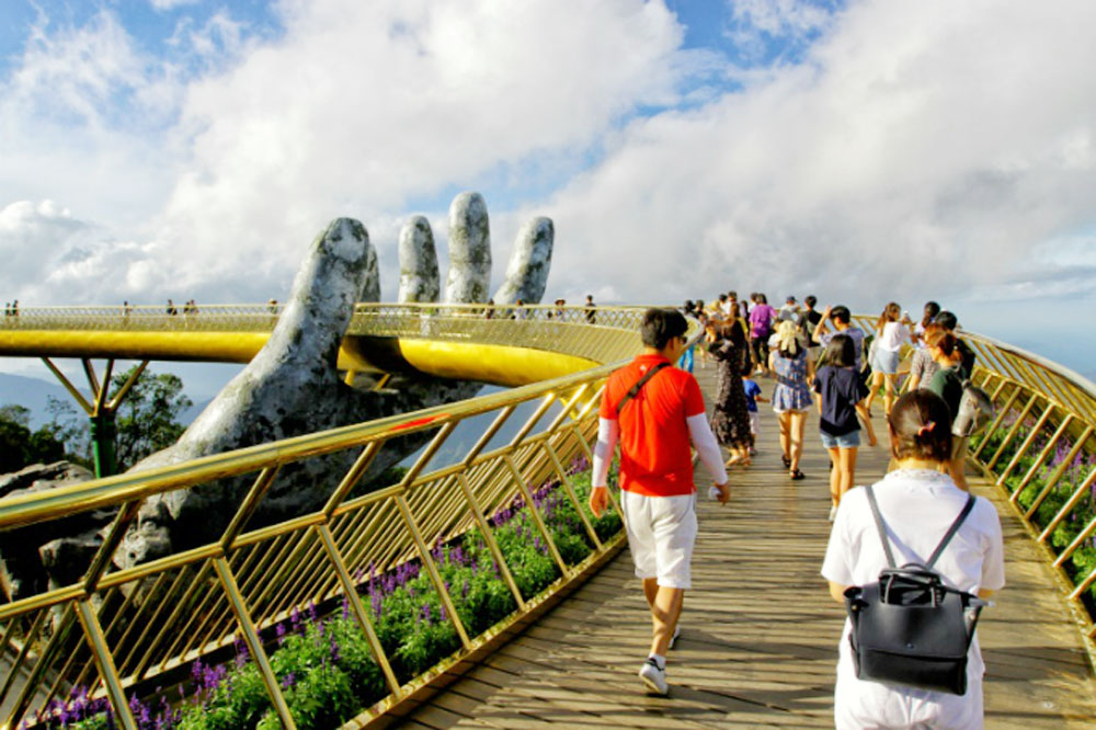 Vietnam's Golden Bridge, Time's top 100, 2018 destinations, world's attention, World's Greatest Places, architectural creativity, massive stony hands, international media outlets, Ba Na Hills