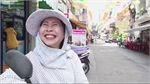 A Saigon xe om lady who can't stop smiling