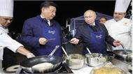 Tổng thống Putin và Chủ tịch Tập Cận Bình nướng bánh kếp và ăn trứng cá hồi