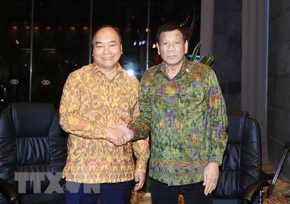 PM Nguyen Xuan Phuc, ASEAN leaders, international organizations, creative growth,  Sustainable Development Goals, World Economic Forum, business environment, harmony mechanism, human resources training