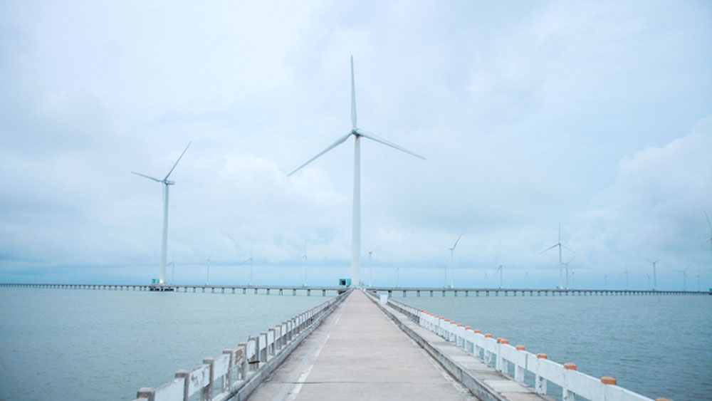 Visitors enjoy the breeze at Vietnam's first and biggest wind farm