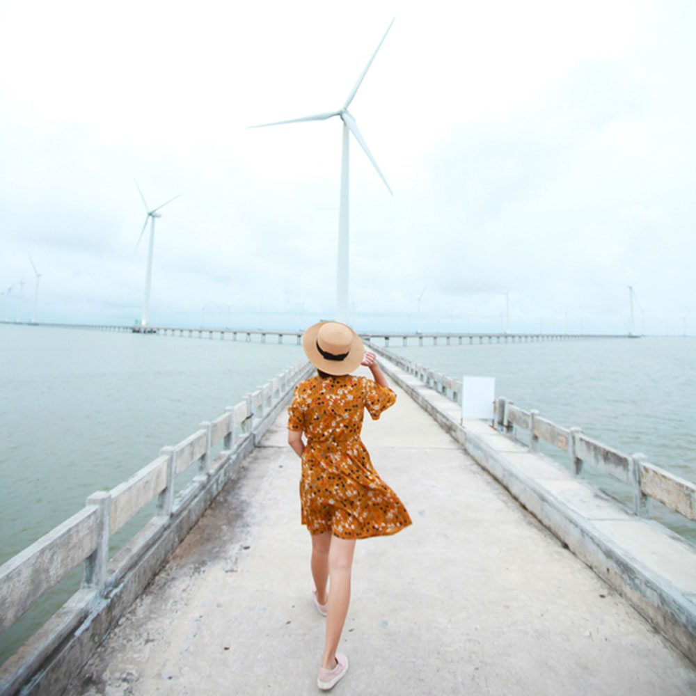 Visitors, Vietnam, first and biggest, wind farm, coastal turbines, continental shelf, imaginary character, sunrise and sunset