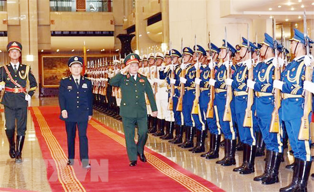 Vietnam, China, beef up, defence ties, Vietnamese military delegation, official visit, strategic cooperative partnership, all-out efforts, fruitful bilateral defence ties, top priority