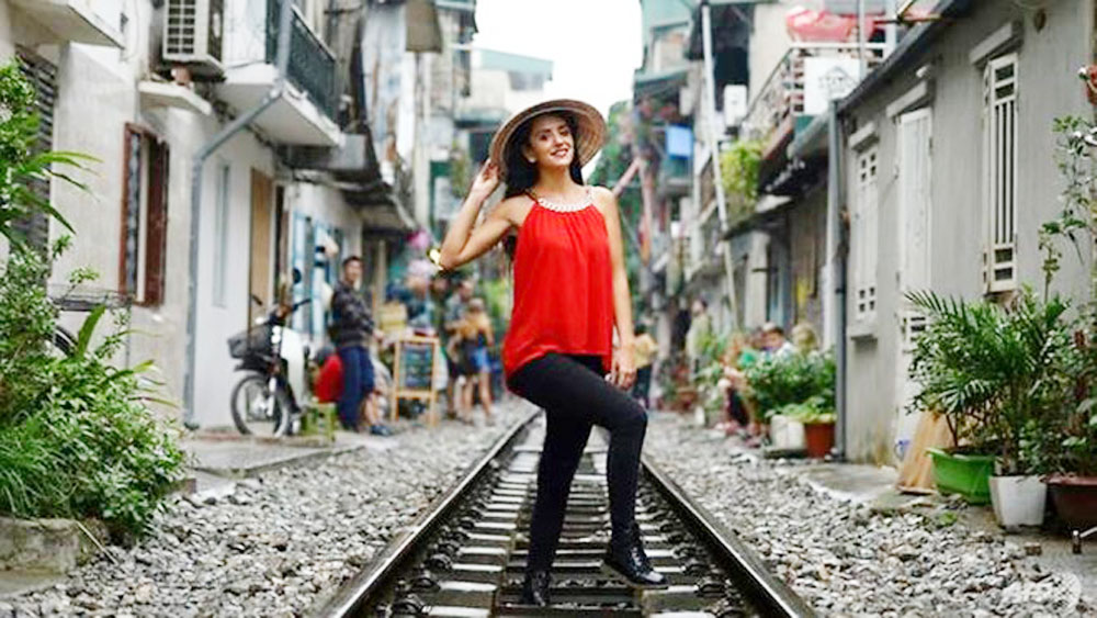 AFP, Hanoi, colonial-era railway, selfie hotspot, Old Quarter, French-built railroad tracks, perfect Instagram selfie, US imperialists