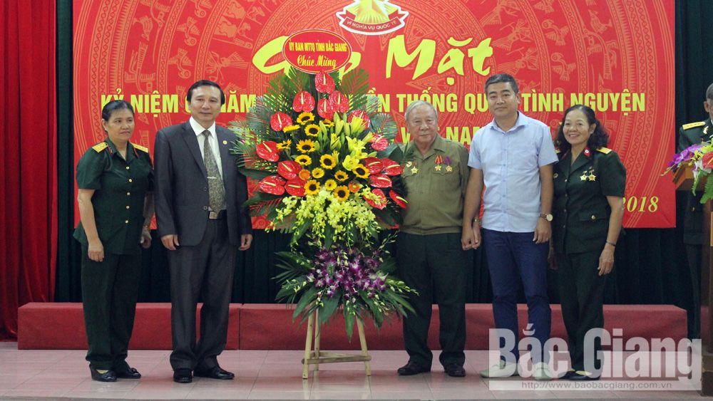 Traditional meeting among Bac Giang provincial Liason Board of Vietnam – Laos voluntary soldiers and military experts