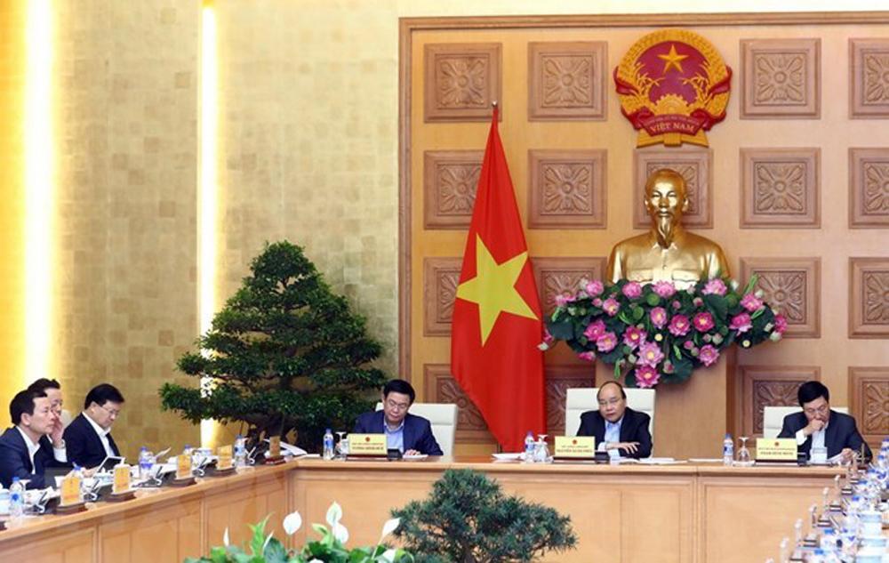 Cabinet, socio-economic development tasks, Prime Minister Nguyen Xuan Phuc, Resolution No.01, cabinet meeting, tax reform, national database, e-payment