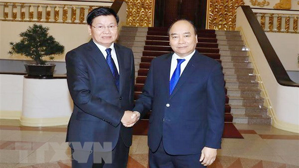 Lao PM, Thongloun Sisoulith, inter-governmental committee meeting, Vietnam, Vietnamese counterpart, Nguyen Xuan Phuc, close-knit traditional friendship, special solidarity, comprehensive cooperation