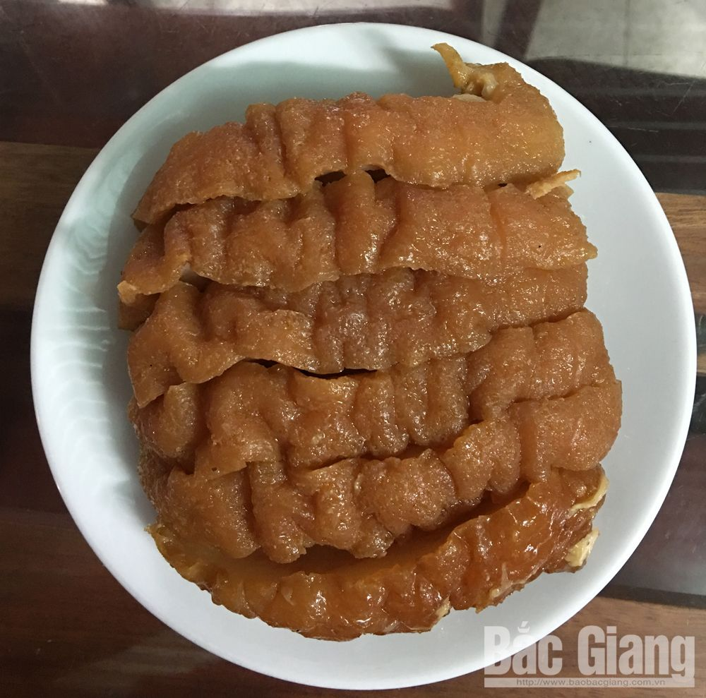 Delicious caramelised and steamed pork, Tet holiday, Bac Giang province, khau nhuc, indispensable dish,  Lunar New Year, eye-catching colour, Hoa ethnic people
