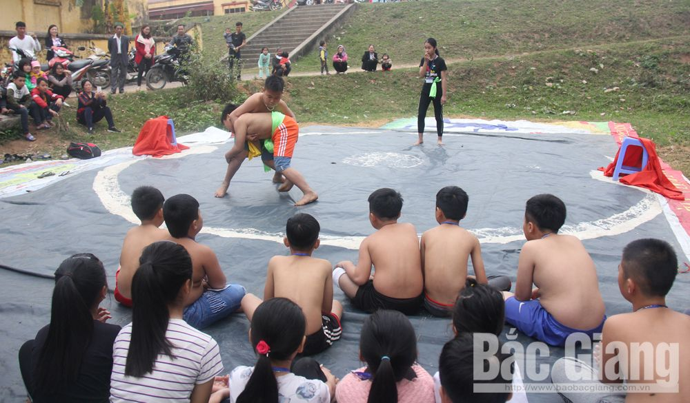 Wrestling arena, Cau River, Bac Giang province, wrestling movement,  young people, old communal house,  attractive matches, gifted young wrestlers