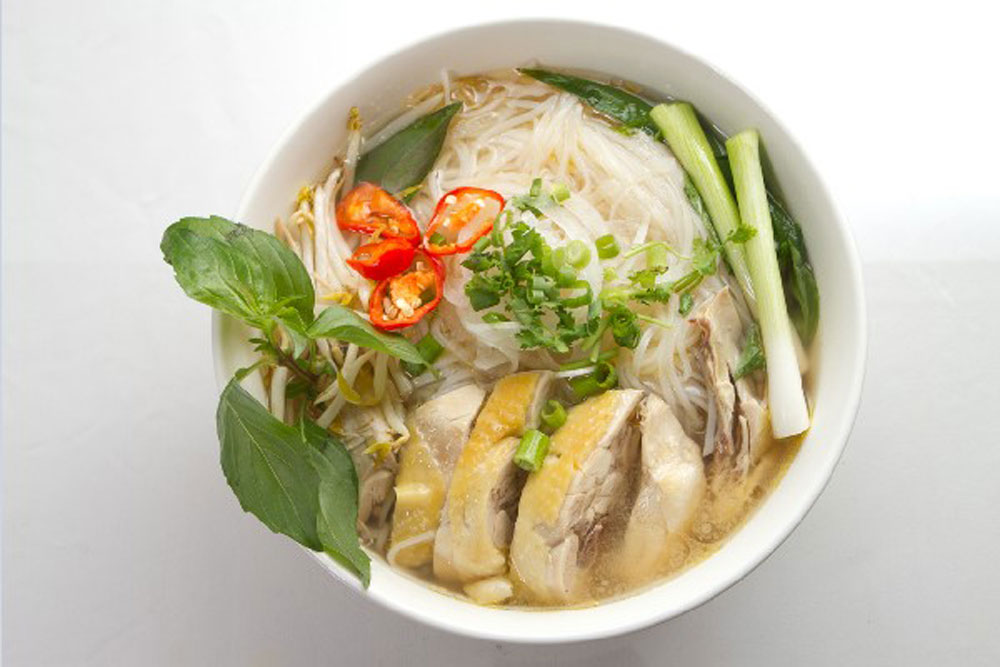 """Vietnam, iconic """"pho"""", noodle soup, best food experience, Lonely Planet, Pho's origin, country's turbulent history, successful street vendors"""