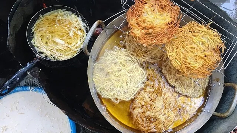 Fried sweet potato cake, delightful popular dish, Vietnamese dessert, wheat flour,  Vietnamese street food, olden brown shells