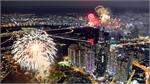 Saigon skyline dazzles to celebrate two historic days