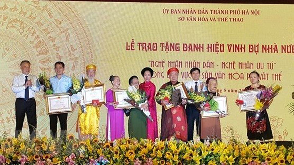 Hanoi, prominent folklore artisans, Temple of Literature,  ceremonial singing, Ai Lao folk dance, religious practice, significant contributions