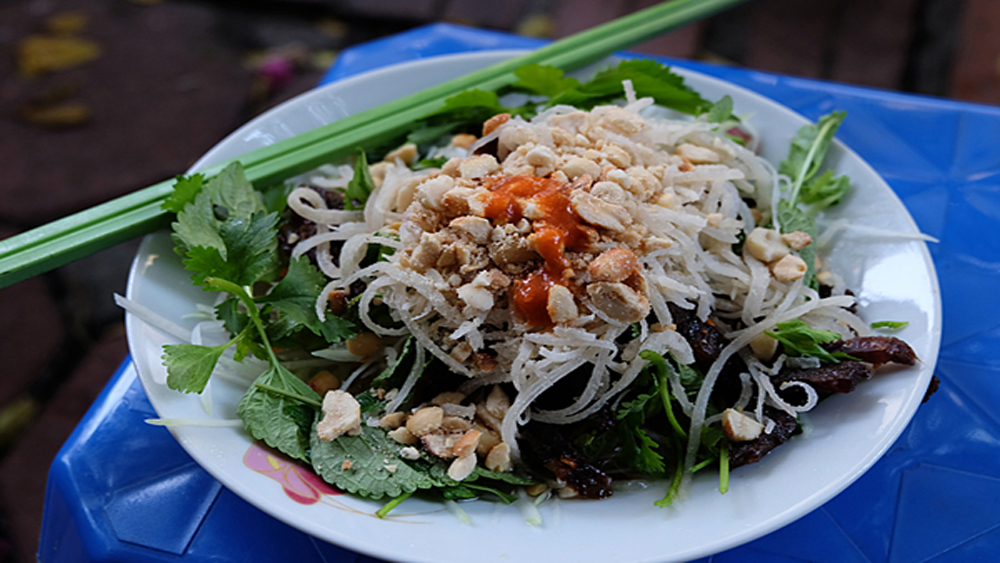 Beef jerky salad and spring rolls: another Hanoi sidewalk treat