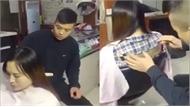 Thanh niên cắt tóc cô gái cắt luôn cả áo
