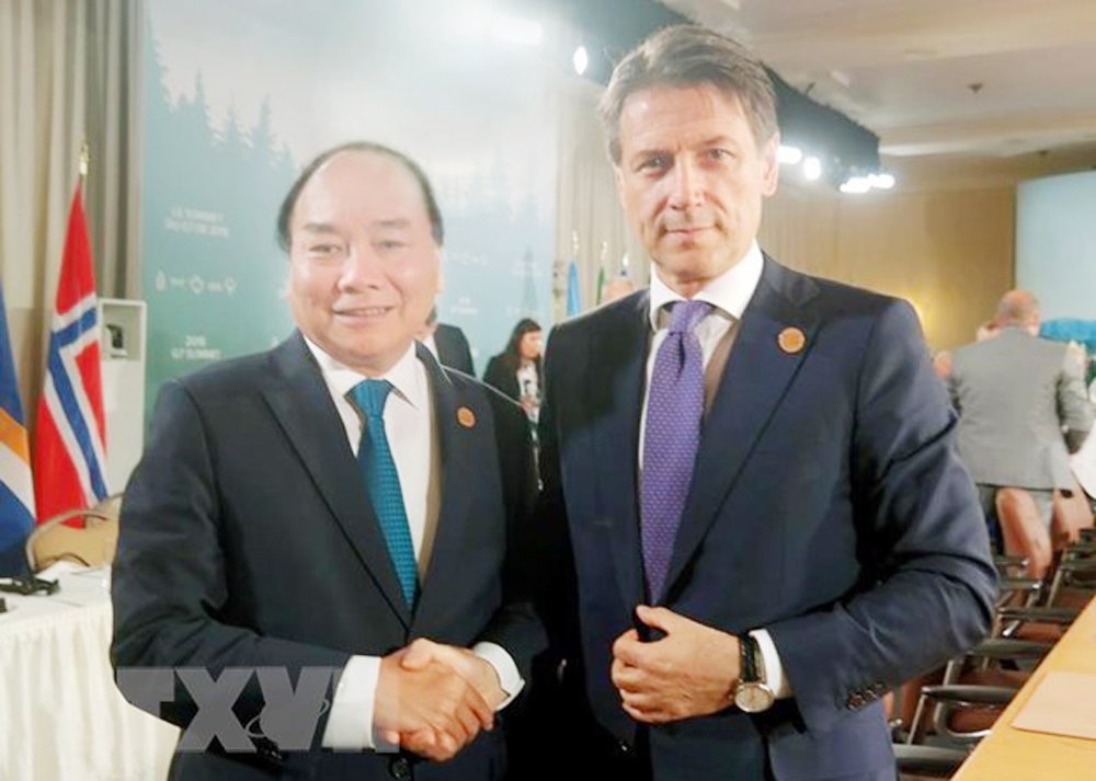 Italian PM, Vietnam visit, bilateral partnership, Vietnam-Italy strategic partnership, political delegations, economic cooperation, biggest trade partner