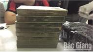 """Được thuê 10 triệu đồng, """"xách"""" 8 bánh heroin từ Sơn La về Bắc Giang tiêu thụ"""