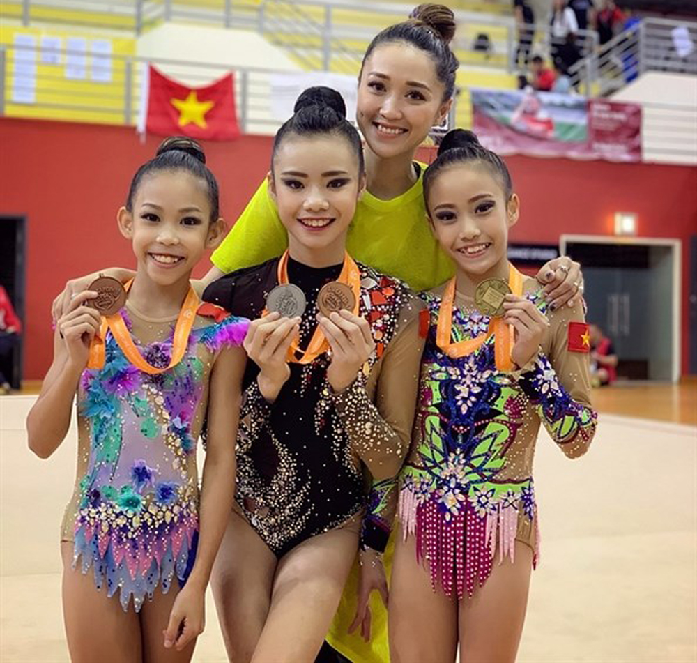 Rhythmic gymnasts, gold medal, Singapore Open, Nguyen Ha My, Vietnam Gymnastics Federation, Luong Gia Linh, Dinh Thanh Huyen
