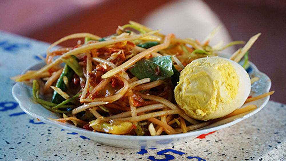 Try the explosion of flavors that is Khmer mixed papaya salad