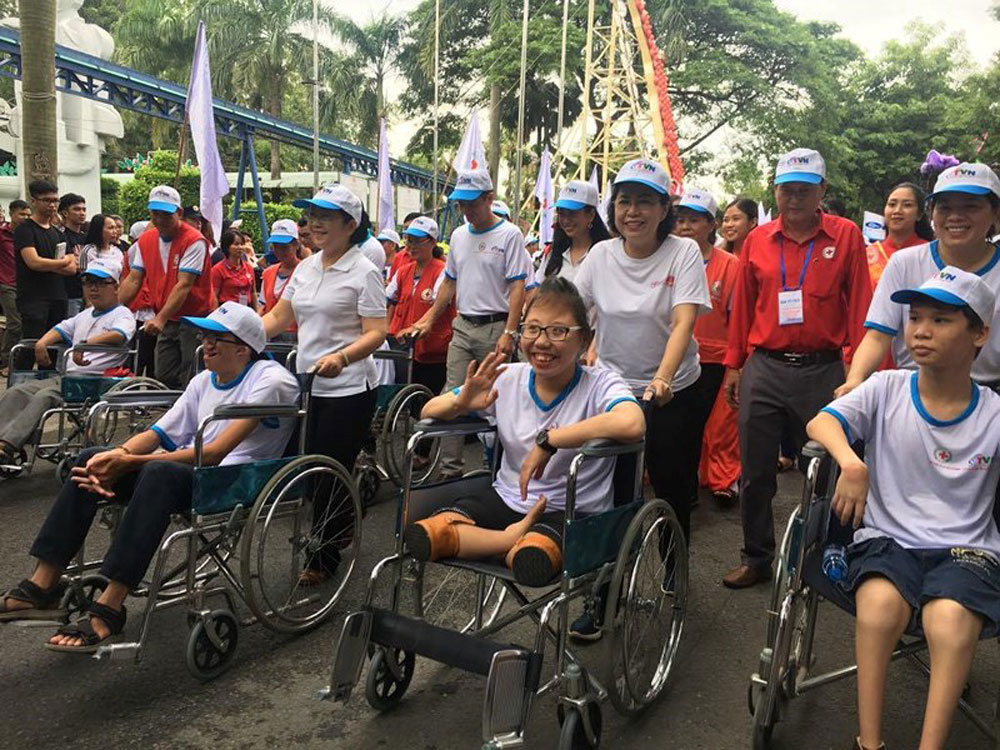 HCM City, walk for AO victims, people with disabilities,Vietnam Red Cross Society, gift packages, better life