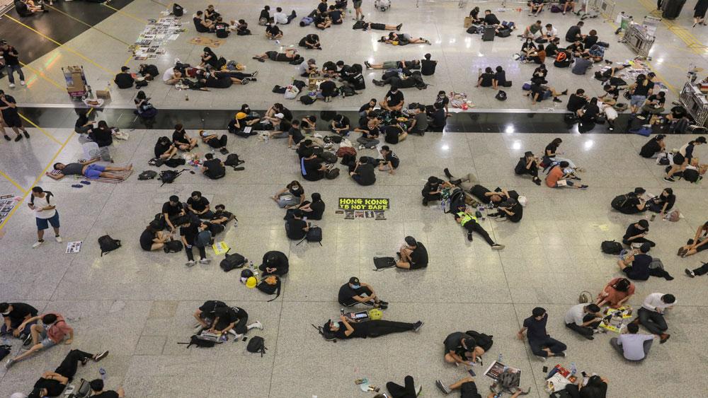 Trung Quốc, sân bay Hong Kong, ngăn cản người gây rối