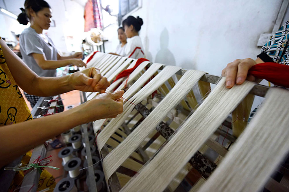 Northern Vietnam village, spins a yarn, Handmade silk,  Co Chat Village, quality and durability, yellow and white silk threads, Silkworm cocoons