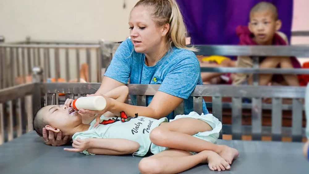 American woman spends her youth caring for disabled Vietnamese kids