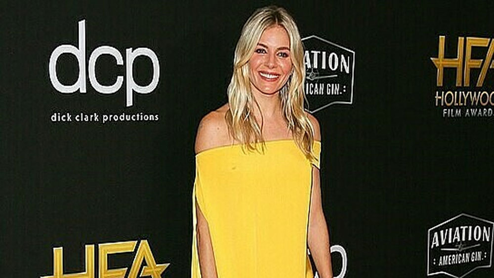 Yellow brilliance as Hollywood star shines in Cong Tri outfit