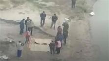 Phát hiện 2 thi thể nghi là bố con bên bờ sông Hồng
