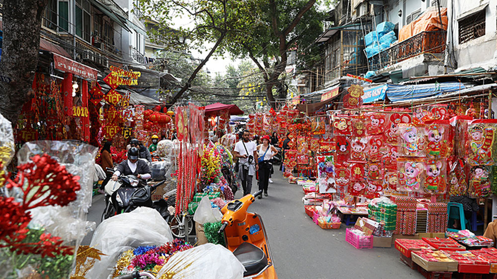 Hanoi's Old Quarter, typical Tet flamboyance, Lunar New Year, flowers and red decor,  most important holiday