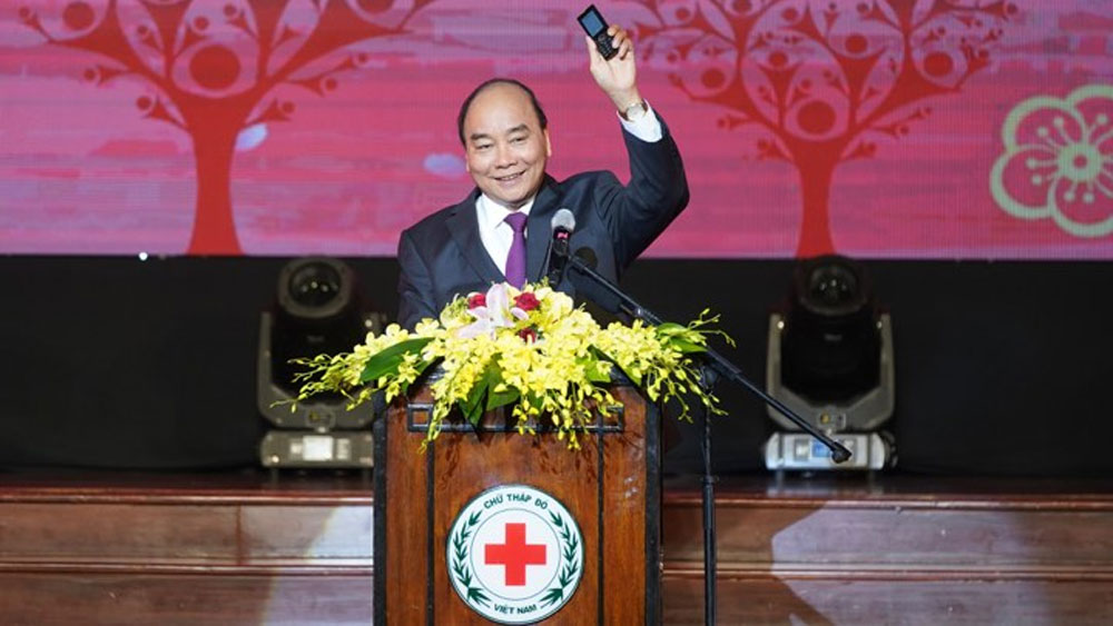 PM, Vietnamese, poor people, Lunar New Year, disadvantaged people,  natural disasters, charity event, Power of Humanitarian Action