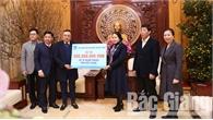 Đồng chí Trần Sỹ Thanh, Chủ tịch Hội đồng thành viên Tập đoàn Dầu khí Việt Nam thăm, trao tặng quà Tết cho người nghèo tỉnh Bắc Giang