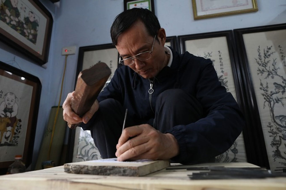 Rat's Weddings, Vietnamese woodcut artist, prepares for Tet, Dong Ho woodcut paintings, highly popular traditional motif, Tet festival