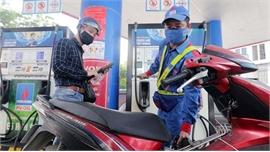 Tăng giá xăng, giảm giá dầu